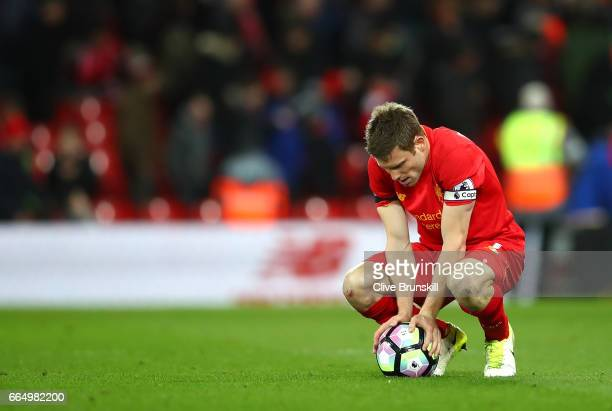 James Milner of Liverpool looks dejected after the Premier League match between Liverpool and AFC Bournemouth at Anfield on April 5 2017 in Liverpool...