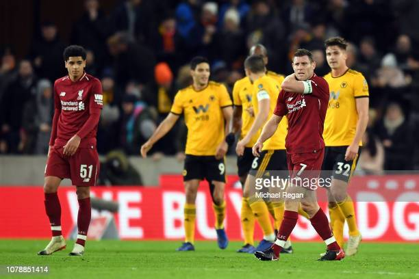 James Milner of Liverpool looks on dejected after Wolves scored the opening goal during the Emirates FA Cup Third Round match between Wolverhampton...