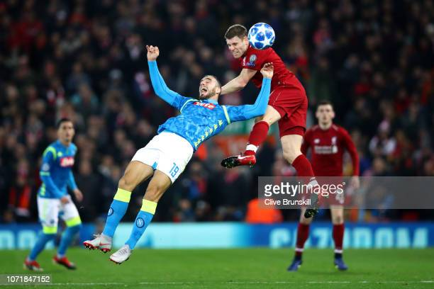 James Milner of Liverpool outjumps Nikola Maksimovic of Napoli during the UEFA Champions League Group C match between Liverpool and SSC Napoli at...