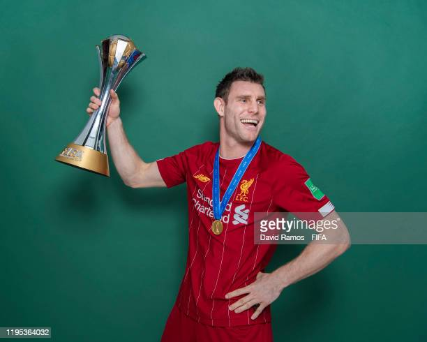James Milner of Liverpool poses with the Club World Cup trophy after the FIFA Club World Cup Qatar 2019 Final match between Liverpool and CR Flamengo...