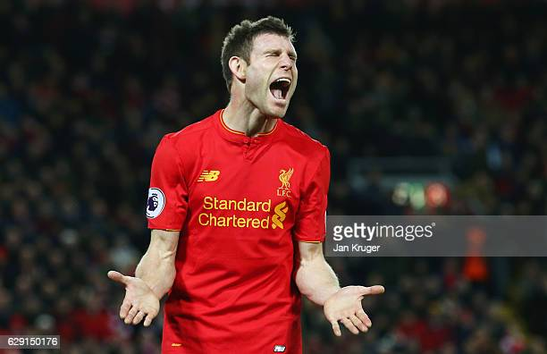 James Milner of Liverpool reacts after missing a chance during the Premier League match between Liverpool and West Ham United at Anfield on December...