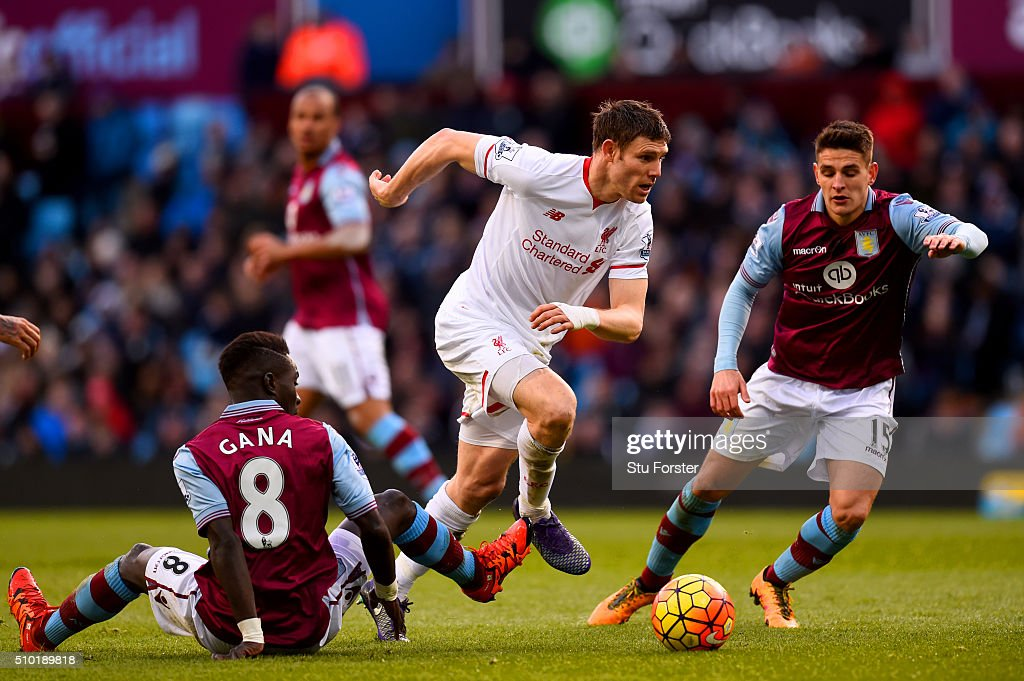 James Milner of Liverpool runs with the ball past Idrissa Gana and Ashley Westwood of Aston Villa during the Barclays Premier League match between Aston Villa and Liverpool at Villa Park on February 14, 2016 in Birmingham, England.