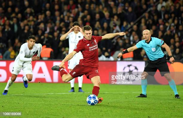 James Milner of Liverpool scores from the penalty spot to score his sides first goal during the UEFA Champions League Group C match between Paris...