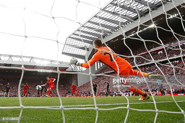 James Milner of Liverpool scores his sides fifth goal fromthe penalty spot past goalkeeper David Marshall of Hull City during the Premier League...