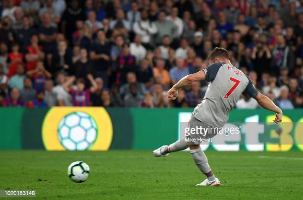 James Milner of Liverpool scores his sides first goal from the penalty spot during the Premier League match between Crystal Palace and Liverpool FC...