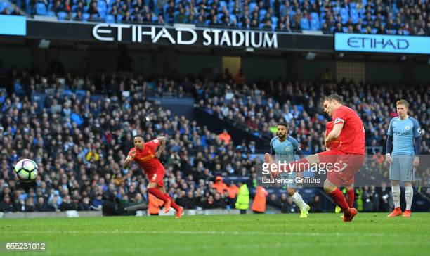 James Milner of Liverpool scores his sides first goal from the penalty spot during the Premier League match between Manchester City and Liverpool at...