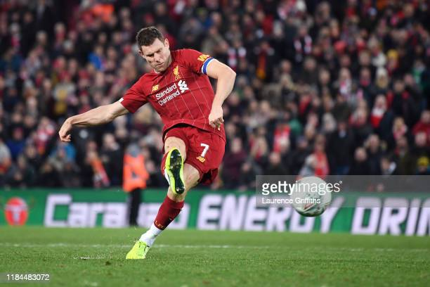 James Milner of Liverpool scores his sides first penalty in the penalty shoot out during the Carabao Cup Round of 16 match between Liverpool and...