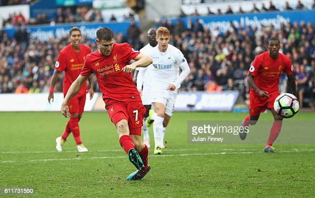 James Milner of Liverpool scores his sides second goal during the Premier League match between Swansea City and Liverpool at Liberty Stadium on...
