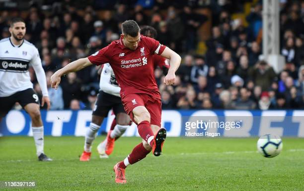 James Milner of Liverpool scores his sides second goal from the penalty spot during the Premier League match between Fulham FC and Liverpool FC at...