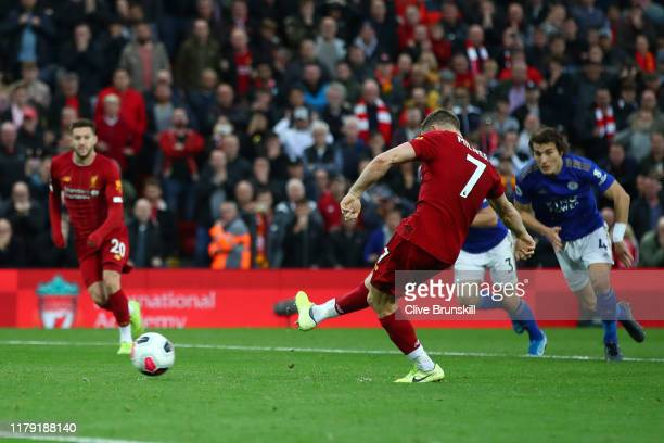 James Milner of Liverpool scores his sides second goal from the penalty spot during the Premier League match between Liverpool FC and Leicester City...