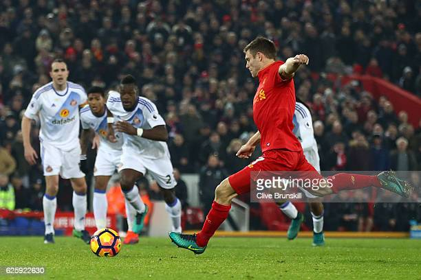 James Milner of Liverpool scores his sides second goal from the penalty spot during the Premier League match between Liverpool and Sunderland at...