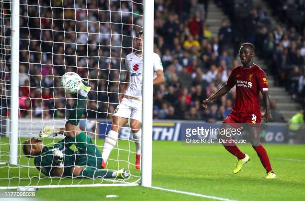 James Milner of Liverpool scores his teams first goal during the Carabao Cup Third Round match between Mk Dons and Liverpool FC at Stadium MK on...