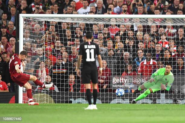 James Milner of Liverpool scores his team's second goal from a penalty past Alphonse Areola of Paris SaintGermain during the Group C match of the...