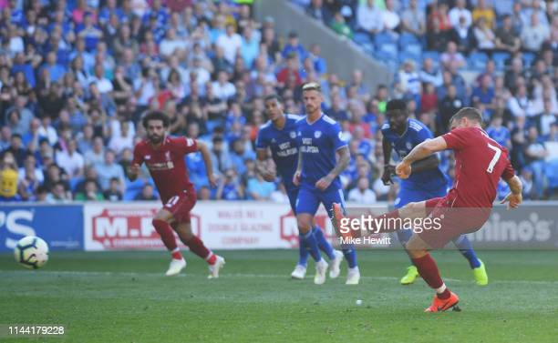 James Milner of Liverpool scores his team's second goal from a penalty during the Premier League match between Cardiff City and Liverpool FC at...