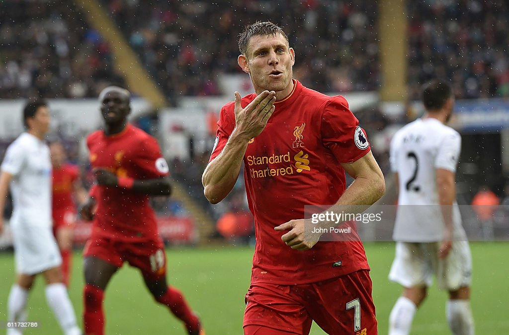 James Milner of Liverpool Scores liverpool second and celebrates with his teamatesduring the Premier League match between Swansea City and Liverpool at Liberty Stadium on October 1, 2016 in Swansea, Wales.