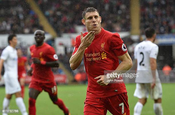 James Milner of Liverpool Scores liverpool second and celebrates with his teamatesduring the Premier League match between Swansea City and Liverpool...