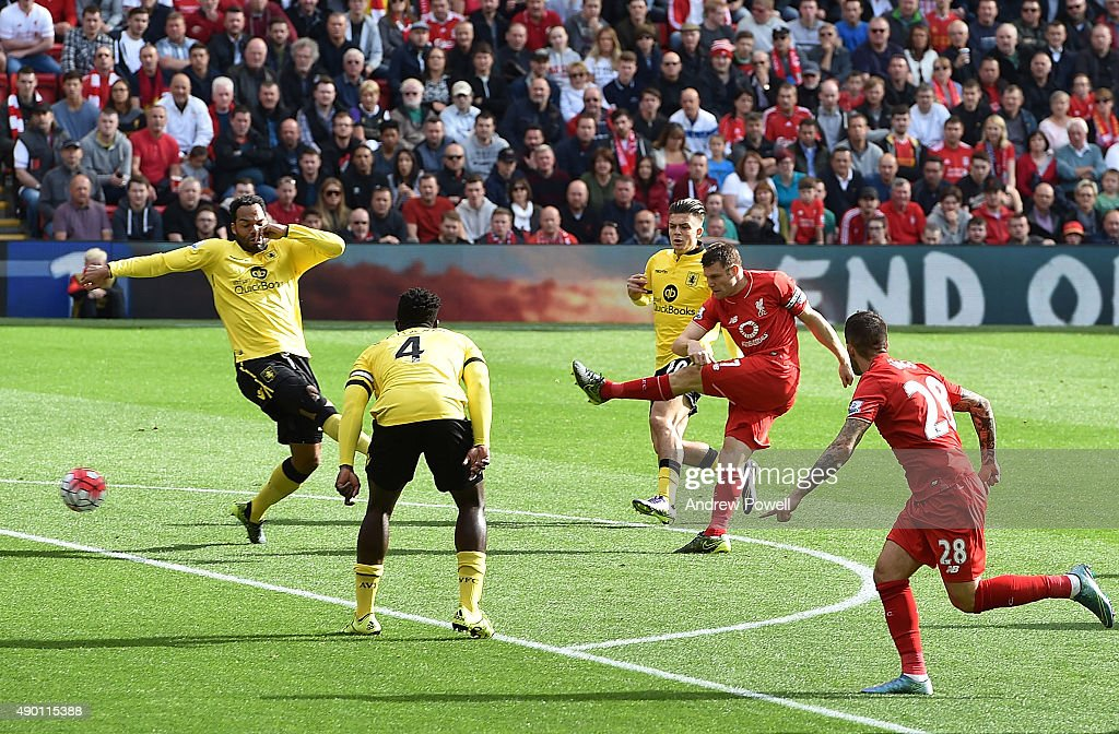 James Milner of Liverpool scores the first goal during the Barclays Premier League match between Liverpool and Aston Villa on September 26, 2015 in Liverpool, United Kingdom.