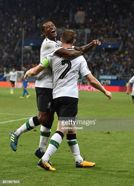 James Milner of Liverpool scores the second and celebrates during the UEFA Champions League Qualifying PlayOffs Round First Leg match between 1899...