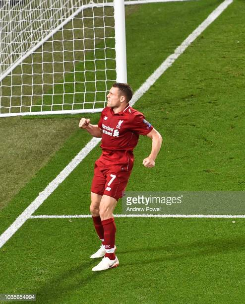 James Milner of Liverpool scores the second goal from the penalty spot and celebrates during the Group C match of the UEFA Champions League between...