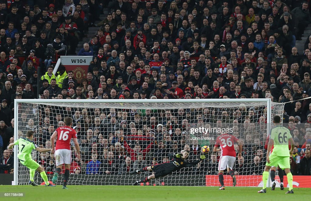 James Milner of Liverpool scores their first goal during the Premier League match between Manchester United and Liverpool at Old Trafford on January 15, 2017 in Manchester, England.