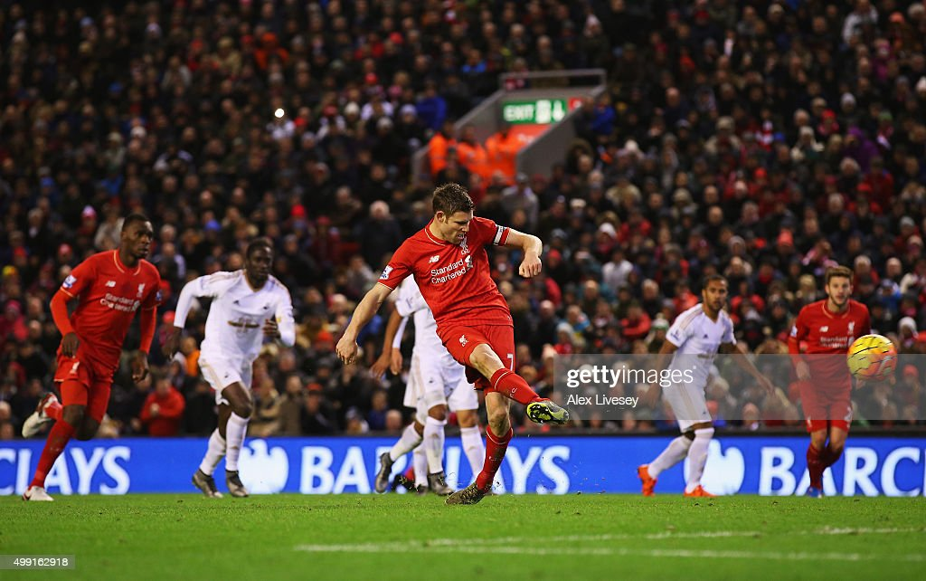 James Milner of Liverpool scores their first goal from a penalty during the Barclays Premier League match between Liverpool and Swansea City at Anfield on November 29, 2015 in Liverpool, England.