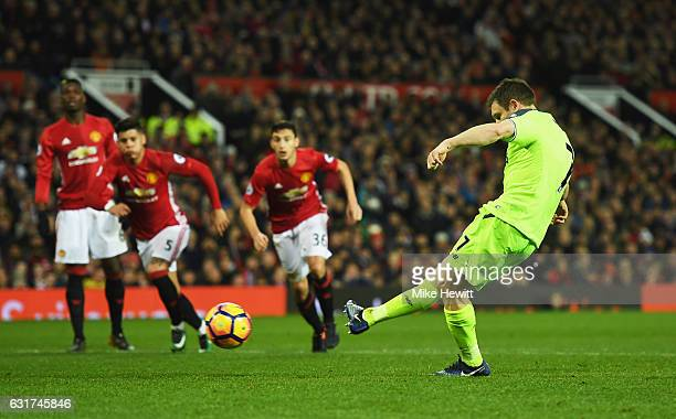 James Milner of Liverpool scores their first goal from a penalty during the Premier League match between Manchester United and Liverpool at Old...