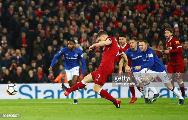 James Milner of Liverpool scores their first goal from the penalty spot during the Emirates FA Cup Third Round match between Liverpool and Everton at...