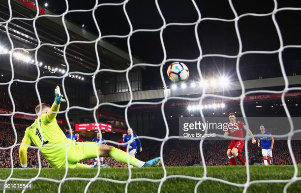 James Milner of Liverpool scores their first goal from the penalty spot past goalkeeper Jordan Pickford of Everton during the Emirates FA Cup Third...