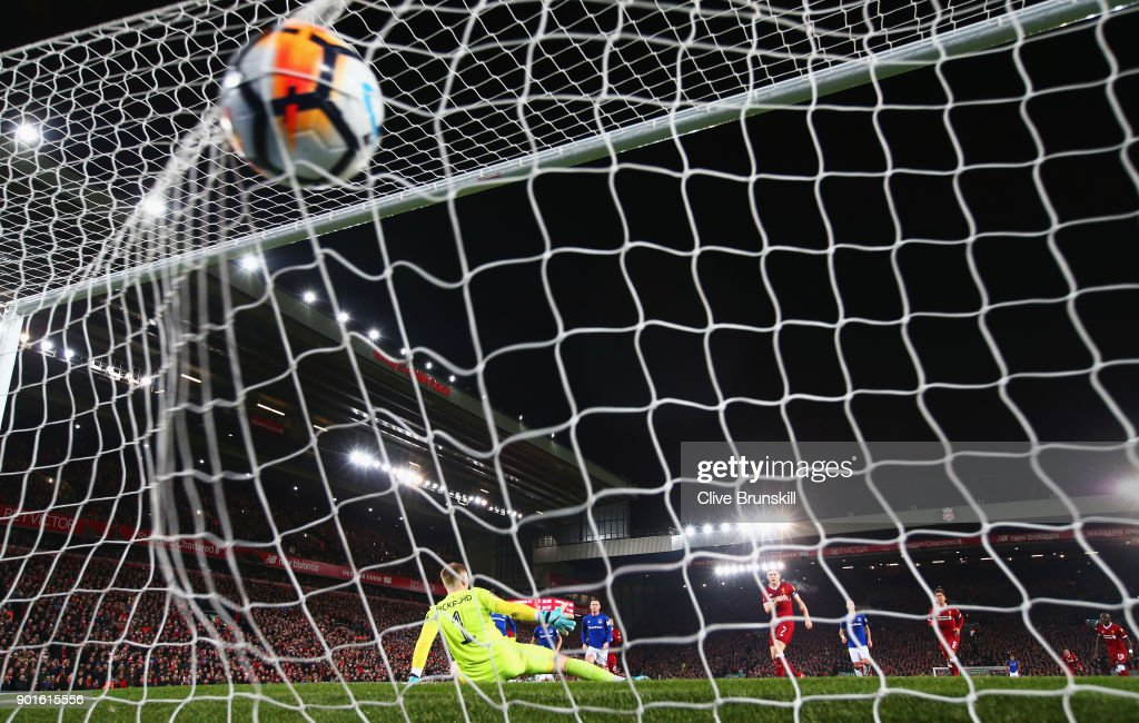 James Milner of Liverpool scores their first goal from the penalty spot past goalkeeper Jordan Pickford of Everton during the Emirates FA Cup Third Round match between Liverpool and Everton at Anfield on January 5, 2018 in Liverpool, England.