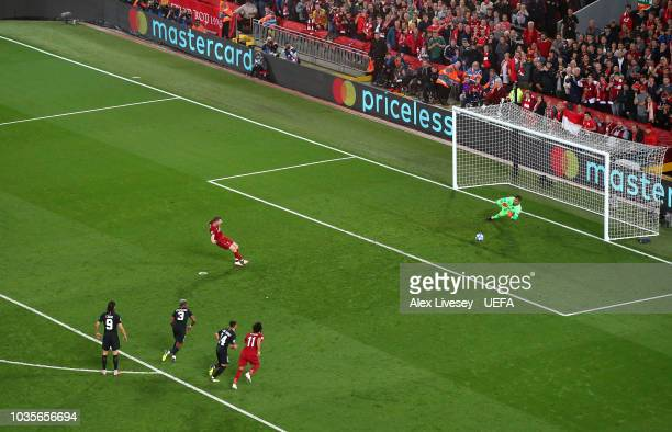 James Milner of Liverpool scores their second goal from the penalty spot during the Group C match of the UEFA Champions League between Liverpool and...