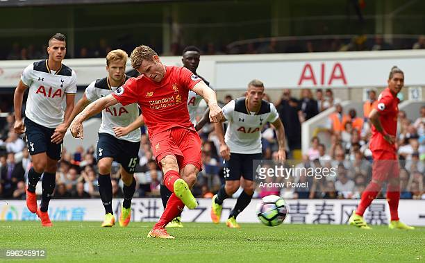 James Milner of Liverpool scoring the opening goal from the penalty spot during the Premier League match between Tottenham Hotspur and Liverpool at...