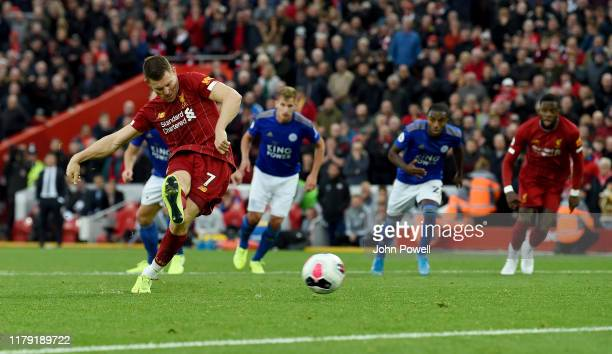 James Milner of Liverpool scoring the winning goal from the penalty spot during the Premier League match between Liverpool FC and Leicester City at...