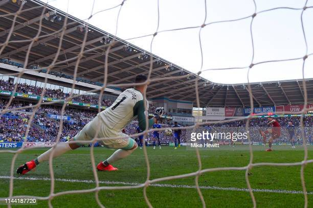 James Milner of Liverpool sends Neil Etheridge of Cardiff City the wrong way from the penalty spot during the Premier League match between Cardiff...