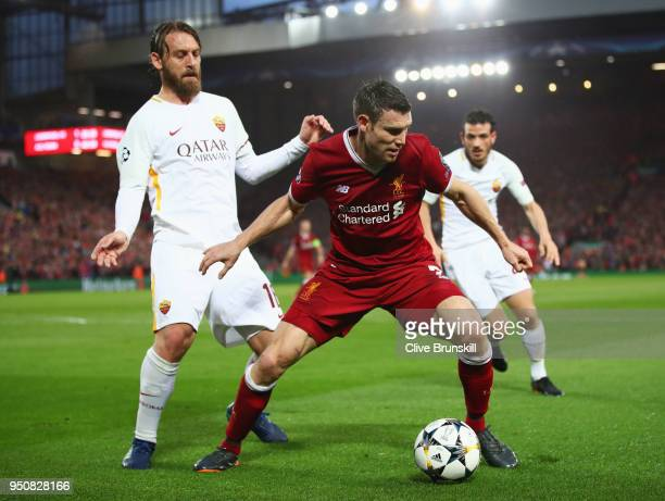 James Milner of Liverpool sheilds the ball from Daniele De Rossi of AS Roma during the UEFA Champions League Semi Final First Leg match between...