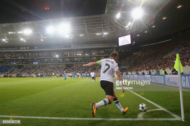 James Milner of Liverpool shoots a corner during the UEFA Champions League Qualifying PlayOffs Round First Leg match between 1899 Hoffenheim and...