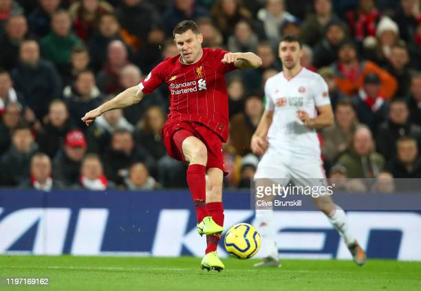 James Milner of Liverpool shoots during the Premier League match between Liverpool FC and Sheffield United at Anfield on January 02, 2020 in...