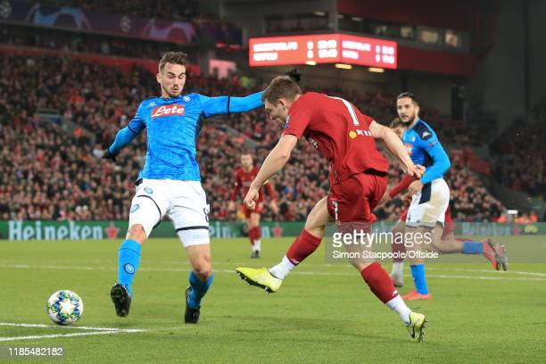 James Milner of Liverpool shoots past Fabian of Napoli during the UEFA Champions League group E match between Liverpool FC and SSC Napoli at Anfield...