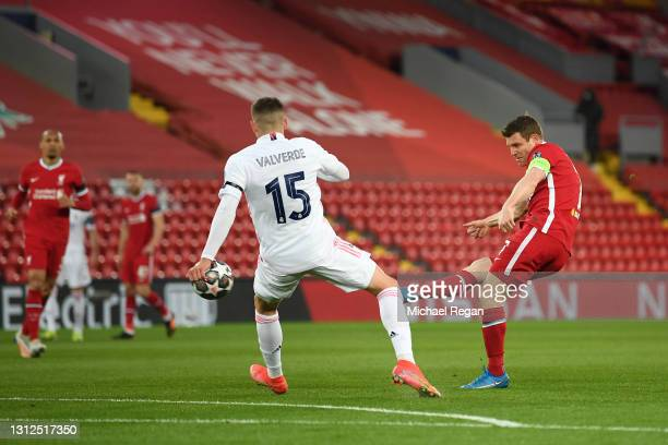 James Milner of Liverpool shoots under pressure from Federico Valverde of Real Madrid during the UEFA Champions League Quarter Final Second Leg match...