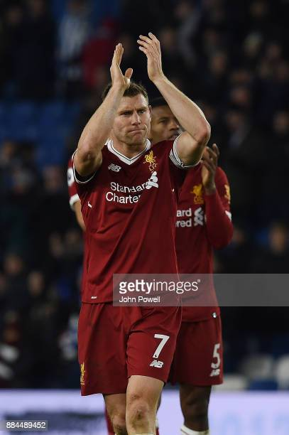 James Milner of Liverpool shows his appreciation to the fans at the end of the Premier League match between Brighton and Hove Albion and Liverpool at...