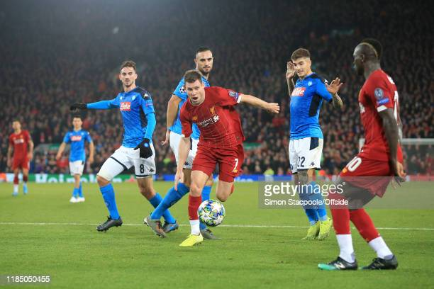 James Milner of Liverpool skips through a trio of Napoli defenders during the UEFA Champions League group E match between Liverpool FC and SSC Napoli...
