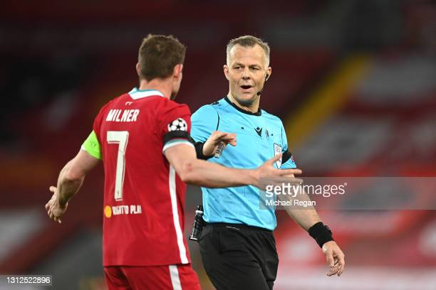 James Milner of Liverpool speaks with Match Referee, Bjorn Kuipers at half time during the UEFA Champions League Quarter Final Second Leg match...