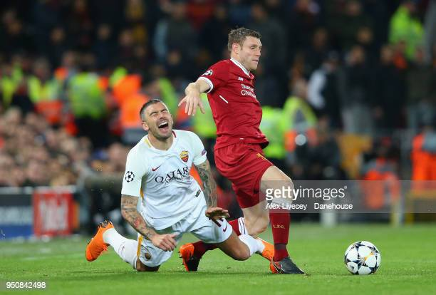 James Milner of Liverpool tackles Aleksandar Kolarov of AS Roma during the UEFA Champions League Semi Final First Leg match between Liverpool and AS...