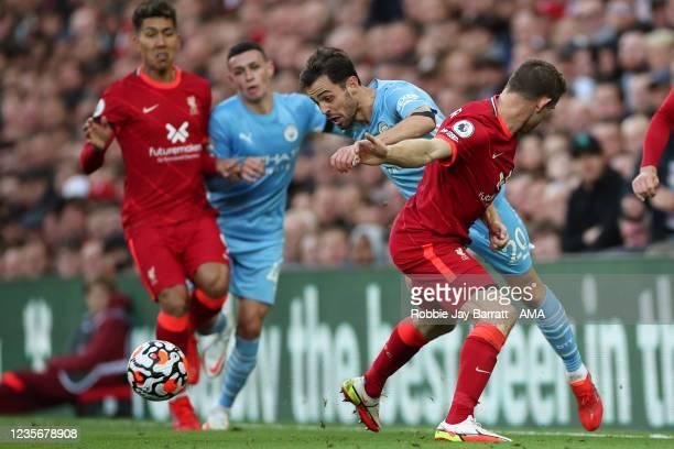 James Milner of Liverpool tackles Bernardo Silva of Manchester City during the Premier League match between Liverpool and Manchester City at Anfield...