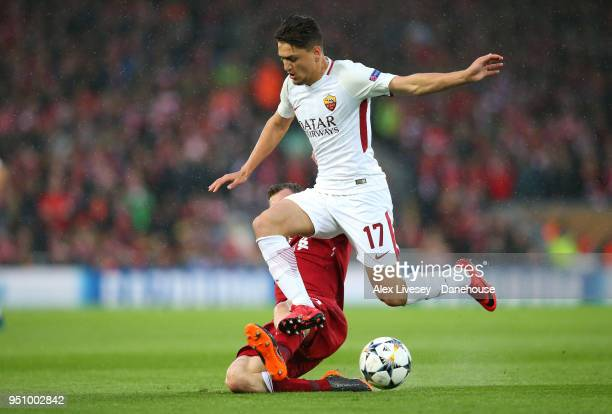James Milner of Liverpool tackles Cengiz Under of AS Roma during the UEFA Champions League Semi Final First Leg match between Liverpool and AS Roma...