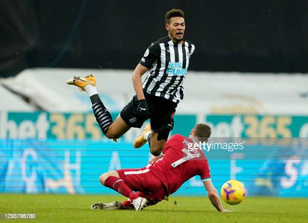 James Milner of Liverpool tackles Joelinton of Newcastle United during the Premier League match between Newcastle United and Liverpool at St. James'...