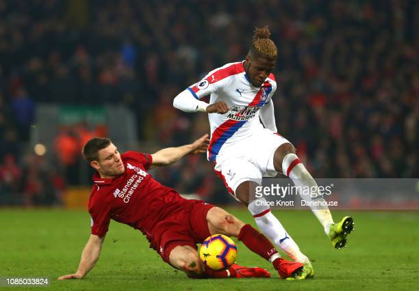 James Milner of Liverpool tackles Wilfred Zaha of Crystal Palace during the Premier League match between Liverpool FC and Crystal Palace FC at...