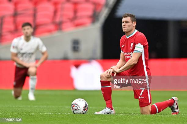 James Milner of Liverpool takes a knee in support of the Black Lives Matter movement during the FA Community Shield final between Arsenal and...