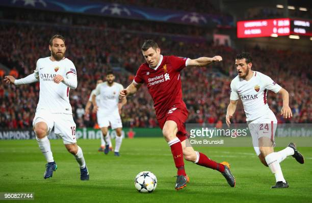 James Milner of Liverpool takes on Daniele De Rossi and Alessandro Florenzi of AS Roma during the UEFA Champions League Semi Final First Leg match...