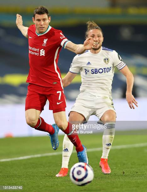 James Milner of Liverpool under pressure from Luke Ayling of Leeds United during the Premier League match between Leeds United and Liverpool at...