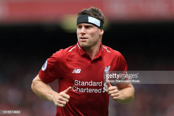 James Milner of Liverpool wears a bandage around his head during the Premier League match between Liverpool and West Ham United at Anfield on August...